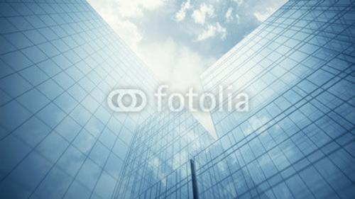 Bild auf Leinwand   Blau glass walls of skyscraper