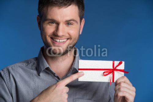 Bild auf Leinwand   Present gift in hands of smiling man.